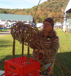 Susie J Gray demonstrates weaving with willow at Vermont Sheep & Wool Festival